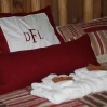DFL - cozy beds, soft white towels and cinnamon stick accents.