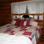 Main lodge - King size hand hewn log bed.