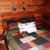 Main lodge bedroom - Queen sized bed with matching dressers. Rustic appeal (lower level access) first class comfort.